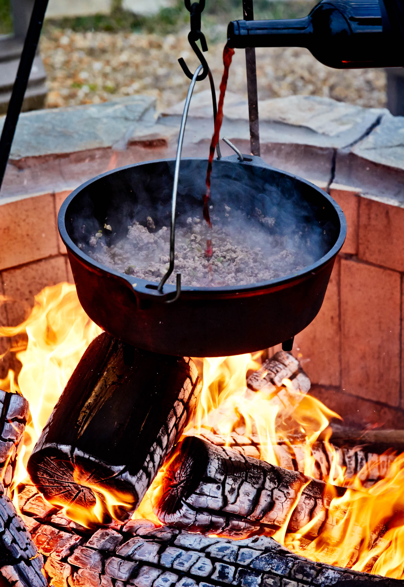 cowboy chili cooking over the fire