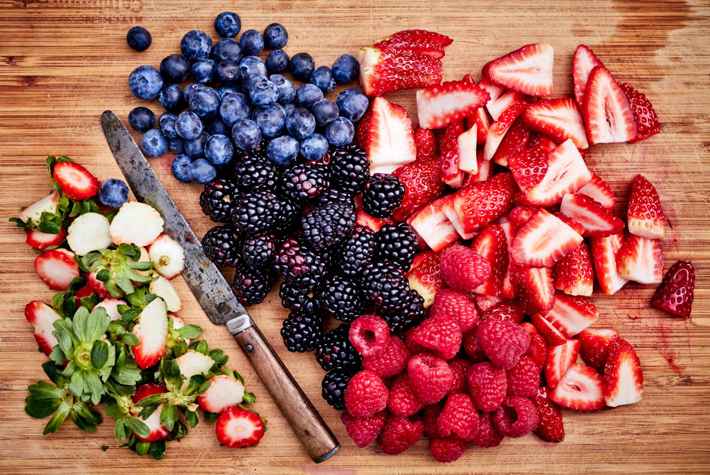 fresh berries on cutting board